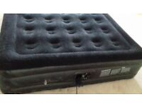 Double inflatable mattress inludes built in air pump