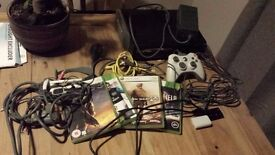 Xbox 360 with 4 games and headset
