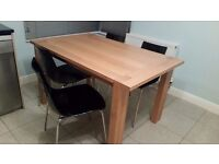 Dining table and 4 black chairs