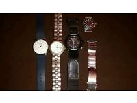 4 watches and a small carriage clock