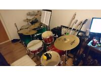 Drum/guitar lessons/teacher/tutor available, Bridgend