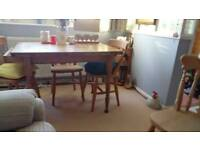 Small solid pine dining table with drawer needs slight attention
