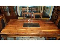 beautiful solid wood dining table and 6 chairs very heavy and strong. Excellent condition