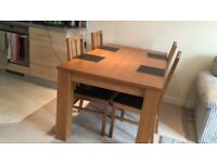 lovely set of dining table and four chairs