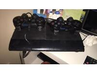 PlayStation 3 super slim and controllers