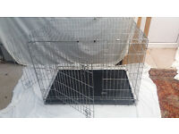 SAVIC folding dog cage. 80 cms high, 70 x 110 cms wide. Good condition. Complete with tray.