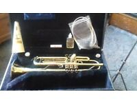 Trumpet complete with hard case, accessories and music stand