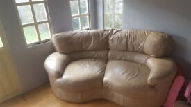 Two seater sofa, single electric recliner and a storage footstool