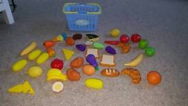 X38 pieces of plastic / wooden play food