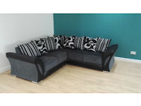 Ex Display Black And Grey Corner Sofa. Approx 240cm By 240cm. Free Delivery Up To 20 Miles