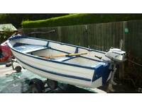 Fishing boat 12'6'' with honda 4 stroke outboard motor and oars.