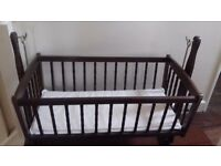 Beautiful baby rocking crib - solid wood with decorative side bars