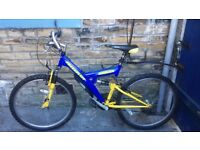 BLUE AND YELLOW FREE SPIRIT DUAL SUSPENSION BIKE FOR SALE