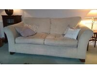 Cream velour sofa