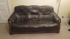 3 Seater Black leather sofa with Dark wood base in great condition!