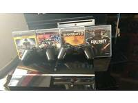 PlayStation 3 with 4 games and 2 controllers special version