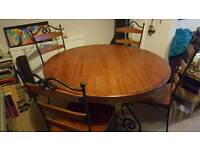 Round dining table and 4 chairs. Wood and iron