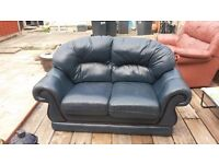 2 blue leather sofas