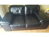 Black leather 2&3 sofa. Selling cheap as new sofa coming next week