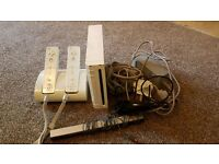 Nintendo Wii with 2 remotes + charger + in great conditions