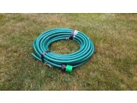 GARDEN HOSEPIPE BRAND NEW NEVER USED FIFTEEN METRES LONG .