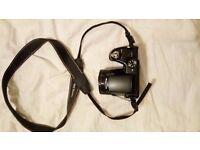Bridge super-zoom compact camera Benq GH700 DSLR