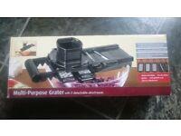 multi-purpose grater with 5 detachable attachments