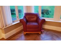 Two large red leather armchairs, excellent condition, very comfortable and solid chairs