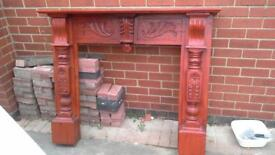 ornate wooden fire surround