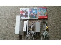 Ninendo wii console with sensor bar,remote and 3 games