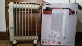 Heater oil fired radiator 2000w. Almost never used. adjustable thermostat, 3 heat settings
