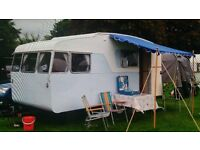 Vintage/classic caravan 1961 sprite musketeer/t with wrap around front windows and tip down bed
