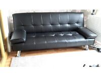Black leather look sofa/bed