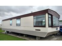 Caravan two bedrooms ensuite bathroom and separate toilet fitted kitchen and dining area