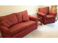 Three seat sofa, two seat sofa and single arm chair. Rust red.