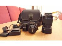 Samsung NX1000 with 20-50 & 50-200 lenses plus bag.