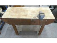solid wooden workbench, with a 5 mm metal top, and an engineers vice. can deliver