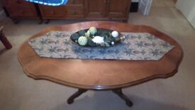 Italian mahogany coffee table with featured pedastal base