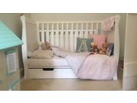 Beautiful white sleigh cot with storage drawer. Comes with mattress