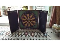 Dart board in mahogany effect case