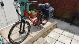 FreeGo Hawk eBike red with panniers and helmet nearly new looking for quick sale