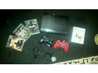 PS3 Super Slim 500GB With 3 Games And 3 Controllers