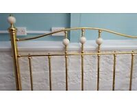All brass and ceramic headboard