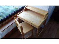 Small wooden child's desk and chair