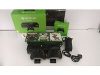 Xbox one boxed and with wrapping, 2 Controllers with rechargeable battery packs and kit, and 3 Games