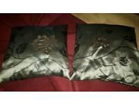2x brown cushions