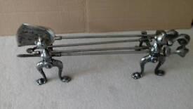 Polished steel fire dog companion set