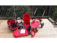 Red Mia Moda Travel System. Complete with all accessories, car seat and base, snug, new rain cover.