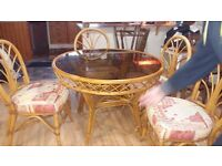 Smoked glass conservatory table and 4 chairs in excellent condition. Delivery can be arranged