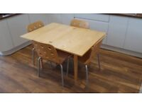 Extending dining table & 4 stackable chairs